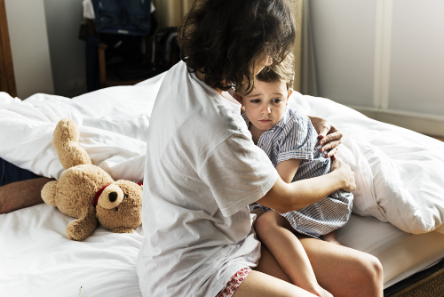 Mother comforting child awakened by a nightmare