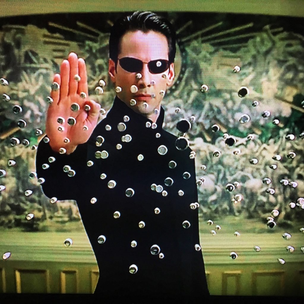 Keanu Reeves as Neo in The Matrix, a movie about simulation